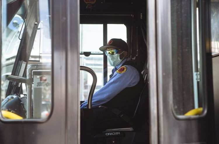 wearing a mask in a bus