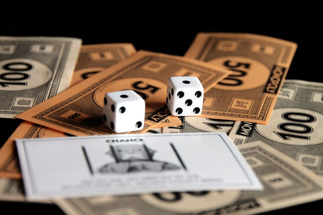 Game cards, money and dice from Monopoly
